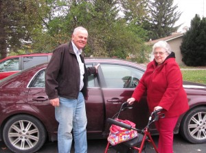 LCCC volunteer assisting senior client with transportation to medical appointment.